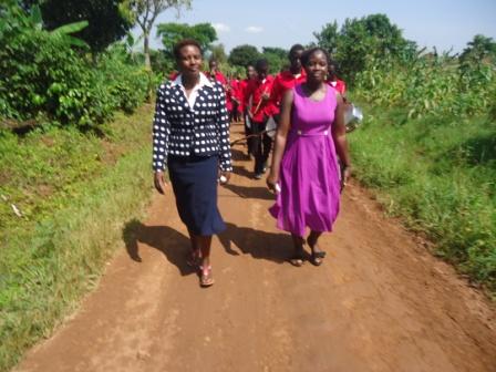 Melon and Aidah marching followed by the 1st Mengo Company Banda - Copy