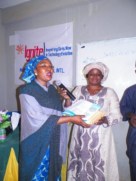 Muhybat Abdulsalam presented books to the host school principal, Edith